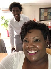 R.J. Ellis, in back, with his mother Nicole Henderson.