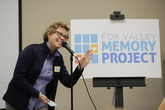Fox Valley Memory Project Executive Director Jill Grambow speaks after unveiling the new logo for the organization on Wednesday at the Goodwill campus in Menasha.