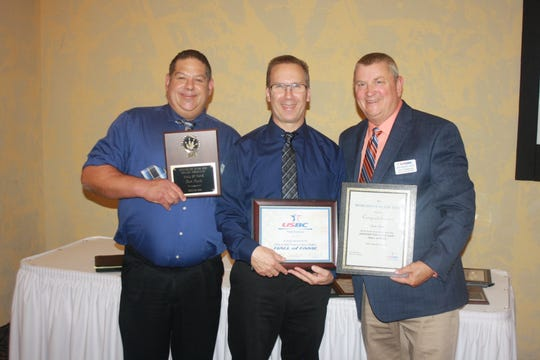 Dan Paul was inducted into the Greater Fox Cities USBC Hall of Fame recently. He is with Greater Fox Cities USBC President Josh Westenberger, left, and Wisconsin USBC association manager Don Hildebrand, right.
