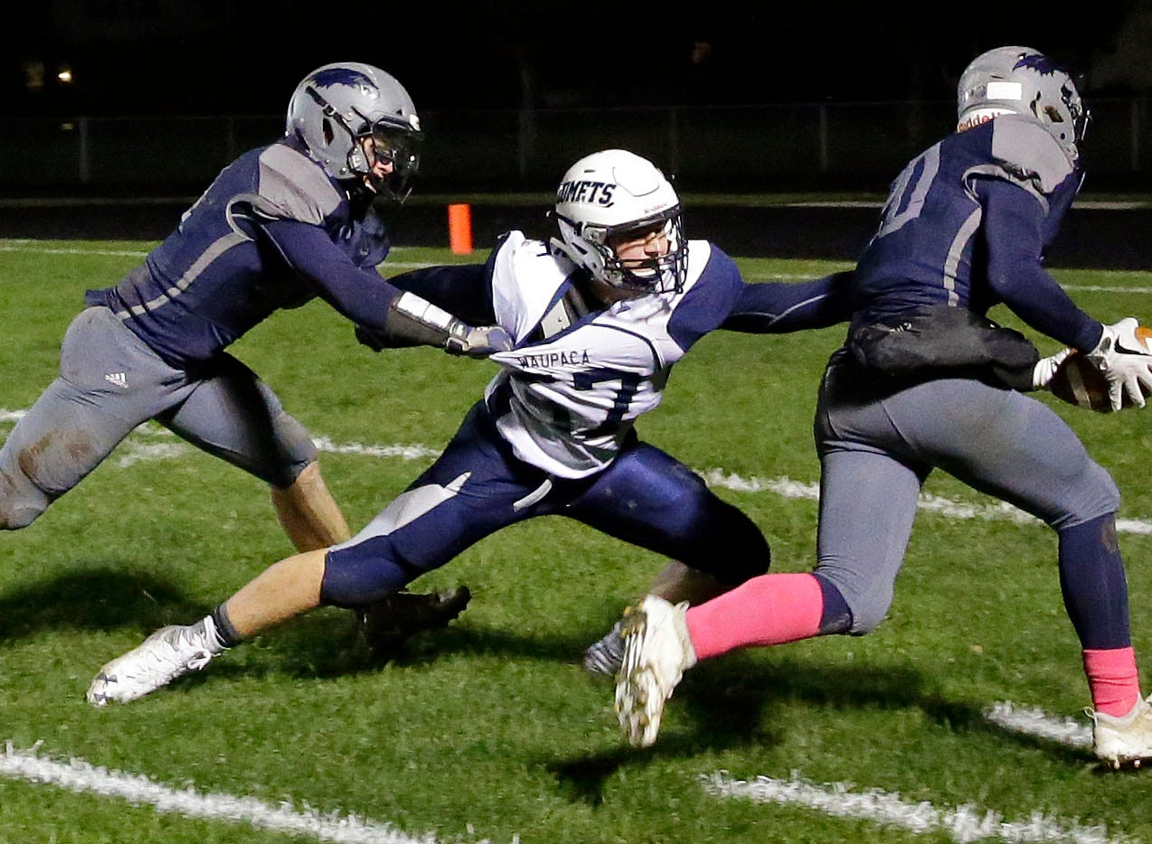 TJ Van Eperen of Xavier gets the ball to the two-yard line before being stopped by Bryce Schuelke of Waupaca in a Bay Conference football game Friday, October 12, 2018, at Rocky Bleier Field in Appleton, Wis.