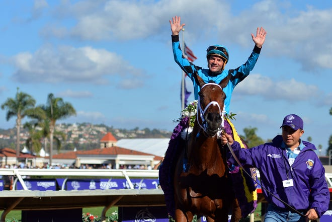 Roy H jockey Kent Desormeaux celebrates after winning the eighth race during the 34th Breeders Cup world championships at Del Mar.