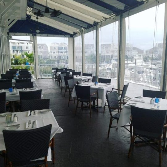 At Joe Amiel's Bay Pointe Inn in Highlands, the outdoor deck has heated floors, and a portion of the space is  enclosed when the weather turns cold.