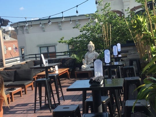 The rooftop deck at Teak overlooks Monmouth Street in Red Bank.