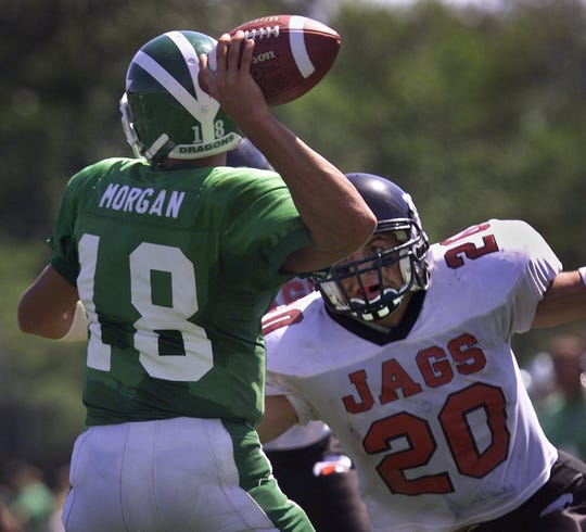 Brick's Bryan Morgan managed to get a throw off before being hit by Jackson 's Joe Serratelli during their 2001 showdown.
