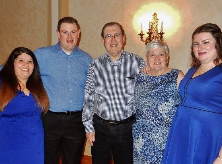 Geralyn Keating Marchini, second from right, with her family: daughter-in-law, Elizabeth; son, Gregory; husband, Claudio; and daughter, Maureen.