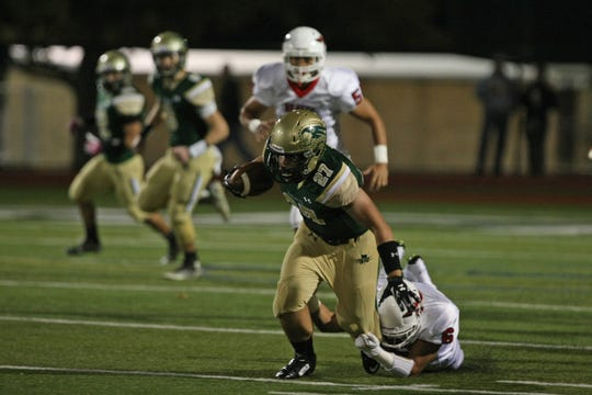Red Bank Catholic's Nick Cella gets good yardage up the middle in 2014 showdown with Manalapan.