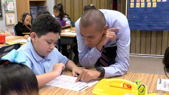 Second grade student Felipe Reyes works on an exercise with teacher Arturo Hernandez at the Ocean Academy Charter School in Lakewood, NJ, Monday, September 17, 2018.