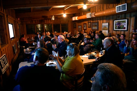 People applaud Beto O'Rourke during his debate against Senator Ted Cruz during a Democratic watch party at Lytle Land & Cattle Company Tuesday Oct. 16, 2018.