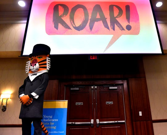 """Mr. Tiger, a storybook character from """"Mr. Tiger Goes Wild"""" by Peter Brown, is introduced during Wednesday's Celebrate the Arts in Abilene luncheon Wednesday. Peter Brown will be the author honored in the 2019 Children's Art & Literacy Festival next spring."""