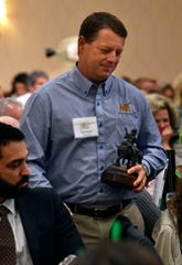 Dan Haught returns to his seat after his company, MasterScapes, was named outstanding business during the 2018 Abilene Art Awards at the Celebrate the Arts in Abilene luncheon Wednesday.