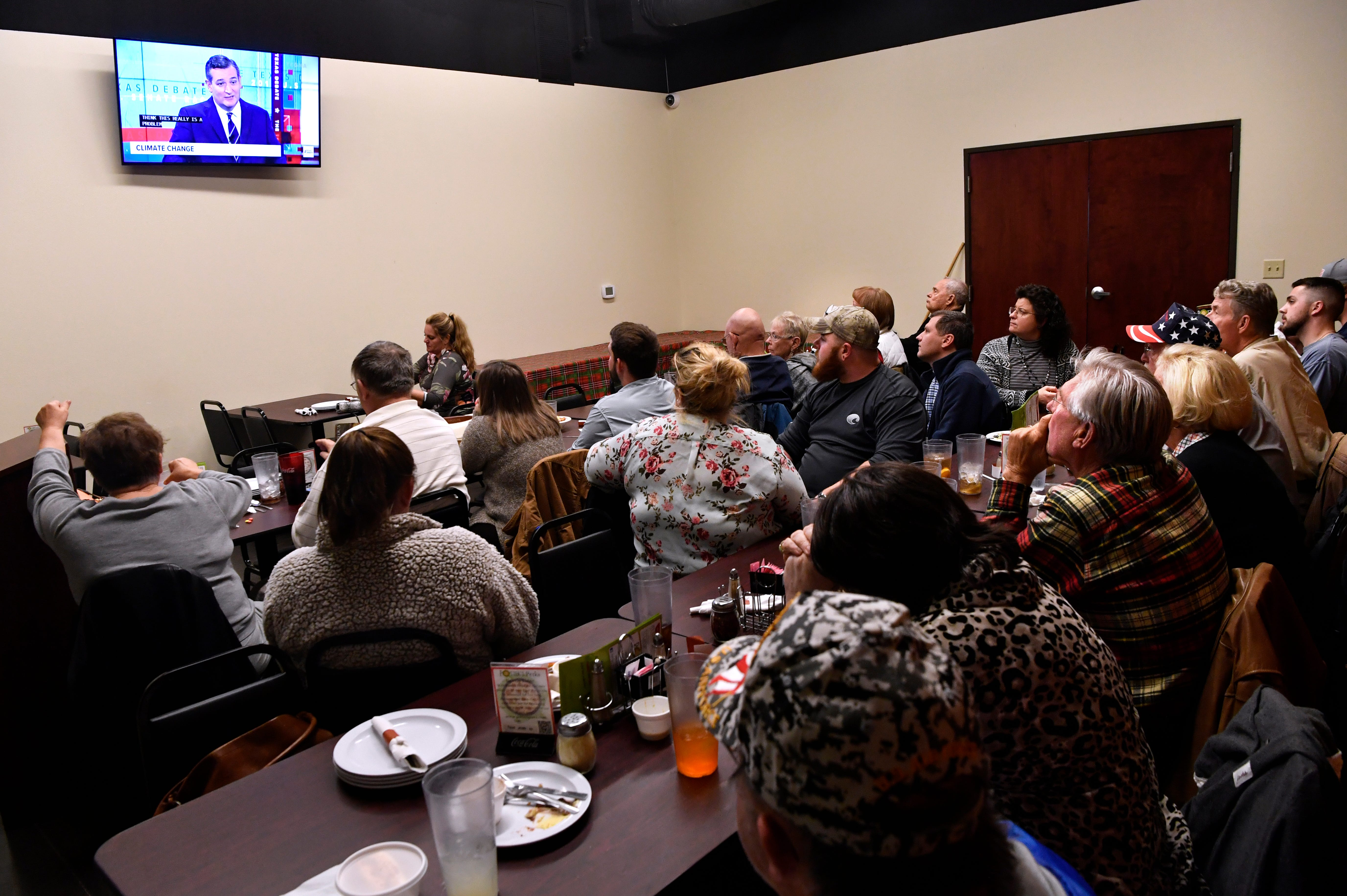 People watch the U.S. Senate debate between Ted Cruz and Beto O'Rourke during a Republican watch party at Potter's Pizza Tuesday Oct. 16, 2018.
