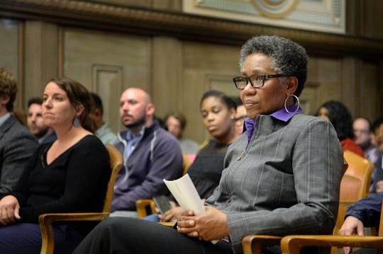 Debra Campbell listens as Asheville City Council discusses their approval of her hiring Wednesday.