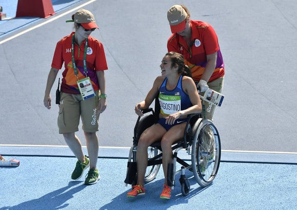 U.S. runner Abbey D'Agostino is wheeled off the track at the 2016 Rio Olympics after a fall in which she tore ligaments in her knee.