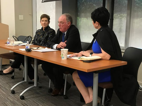 Dr. John Ball, chairman of Mission Health's governing board, discusses plans for the system's sale to HCA Healthcare in October 2018. He is flanked by Janice Brumit, left, chair of the board of Dogwood Health Trust, and Mission official Rowena Buffett Timms, right.
