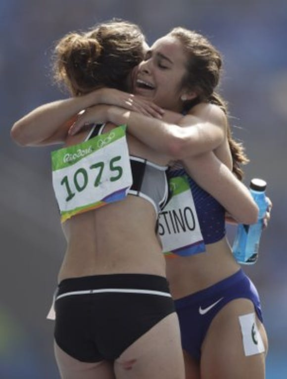 Abbey D'Agostino, right, hugs New Zealand's Nikki Hamblin, after the two fell during a qualifying heat in the 5,000 meter race at the 2016 Rio Olympics.