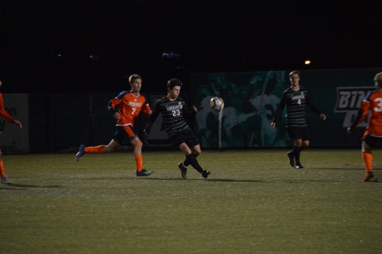 Binghamton University's Miles Burbank prepares to settle a pass as Bucknell's Stefan Golliaz defends during Tuesday's non-conference game at BU. The Bearcats lost, 2-1.