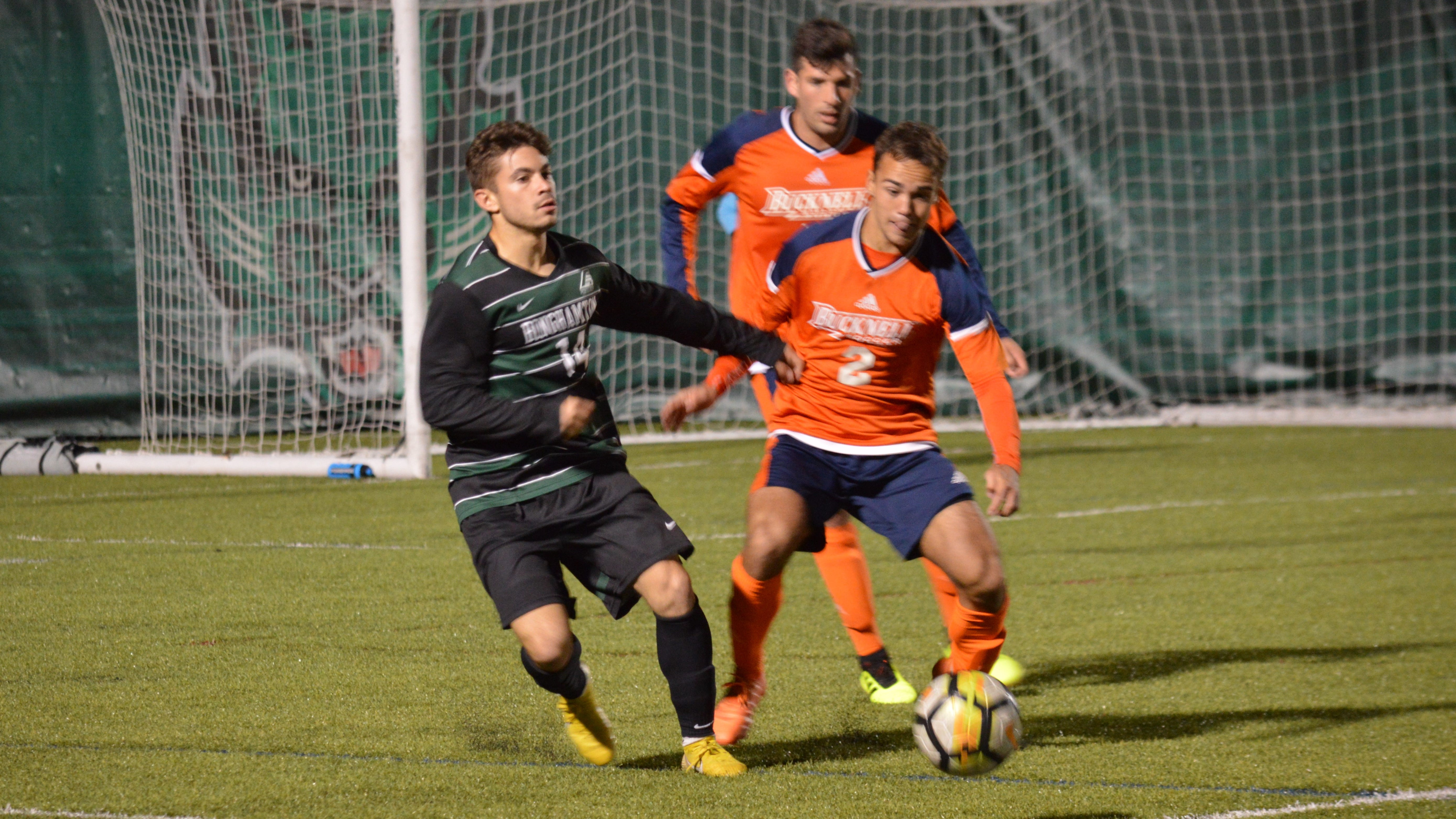 Binghamton University's Connor McKnight and Bucknell's Daniel Halloway battle for possession in Tuesday's non-conference game at BU. The Bearcats lost, 2-1.