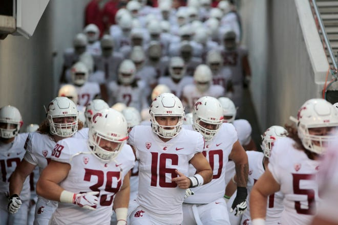Washington State quarterback Gardner Minshew II (16) leads the Cougars onto the field before last week's win over Oregon State in Corvallis.