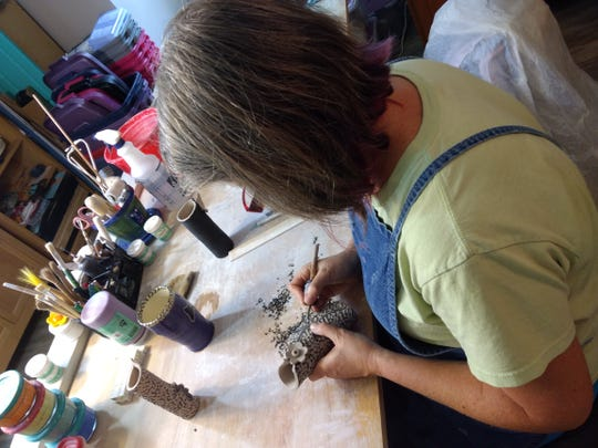 Swannanoa Valley artist Katherine Owen works in her studio. Owen will be one of several local artists at the 21st Annual Art by the Tracks on Saturday, Oct. 27.