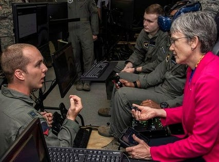 Capt. John Joern, Pilot Training Next instructor, briefs Air Force Secretary Heather Wilson as they observe student pilots train with virtual reality systems at the Armed Forces Reserve Center at Austin-Bergstrom International Airport in Austin, Texas.