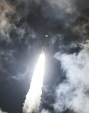 A United Launch Alliance Atlas V soars through the clouds after liftoff from Cape Canaveral Air Force Station Wednesday, Oct 17, 2018, so. The rocket is carrying the Advanced Extremely High Frequency 4 communications satellite for the US Air Force. Mandatory Credit: Craig Bailey/FLORIDA TODAY