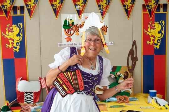 Ann Peterson has fun in the photo area of Advent Lutheran Church's Oktoberfest.