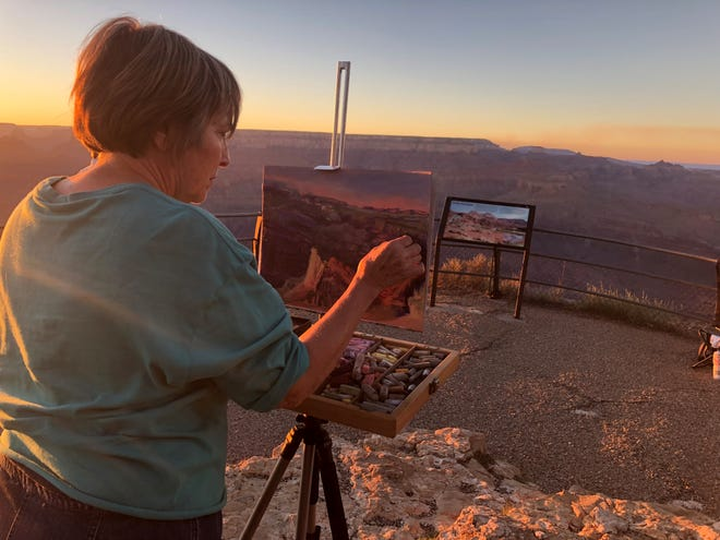 Peg Vasil, of Bucyrus, paints a scene during a recent trip to the Grand Canyon.