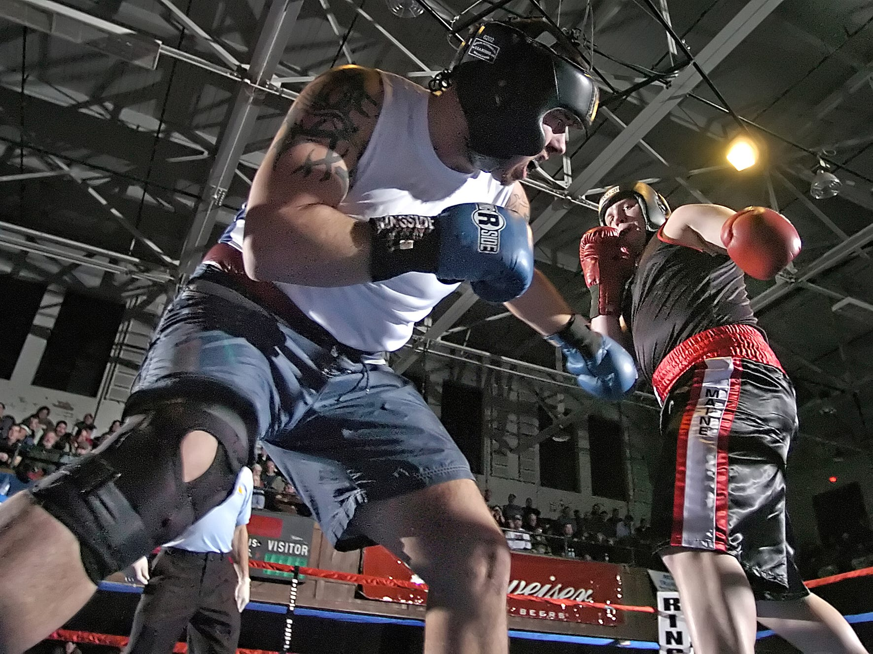 Miles Lovell of Claremont Boxing (left) ducks away from Aaron Emmons of Portland Boxing in their super heavy weight bout at Memorial Auditorium in Burlington on Saturday, February 11, 2006.