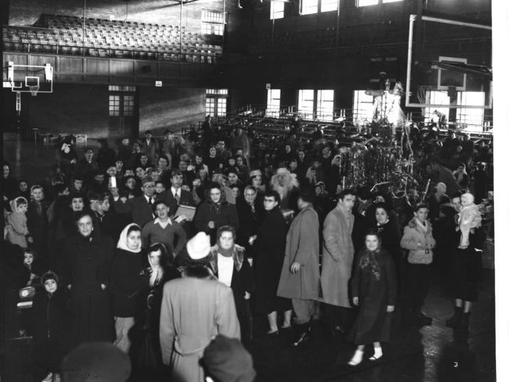 A crowd at Memorial Auditorium gathers for a VFW Christmas bazaar in this photograph from 1952.