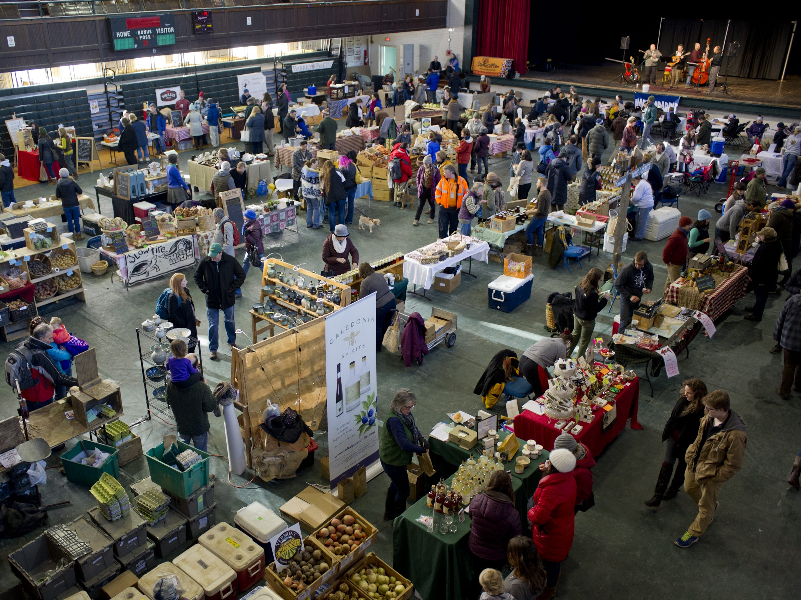 Vendors, customers and performers attend the Winter Farmers Market at Memorial Auditorium in Burlington. on Saturday, January 17, 2015.