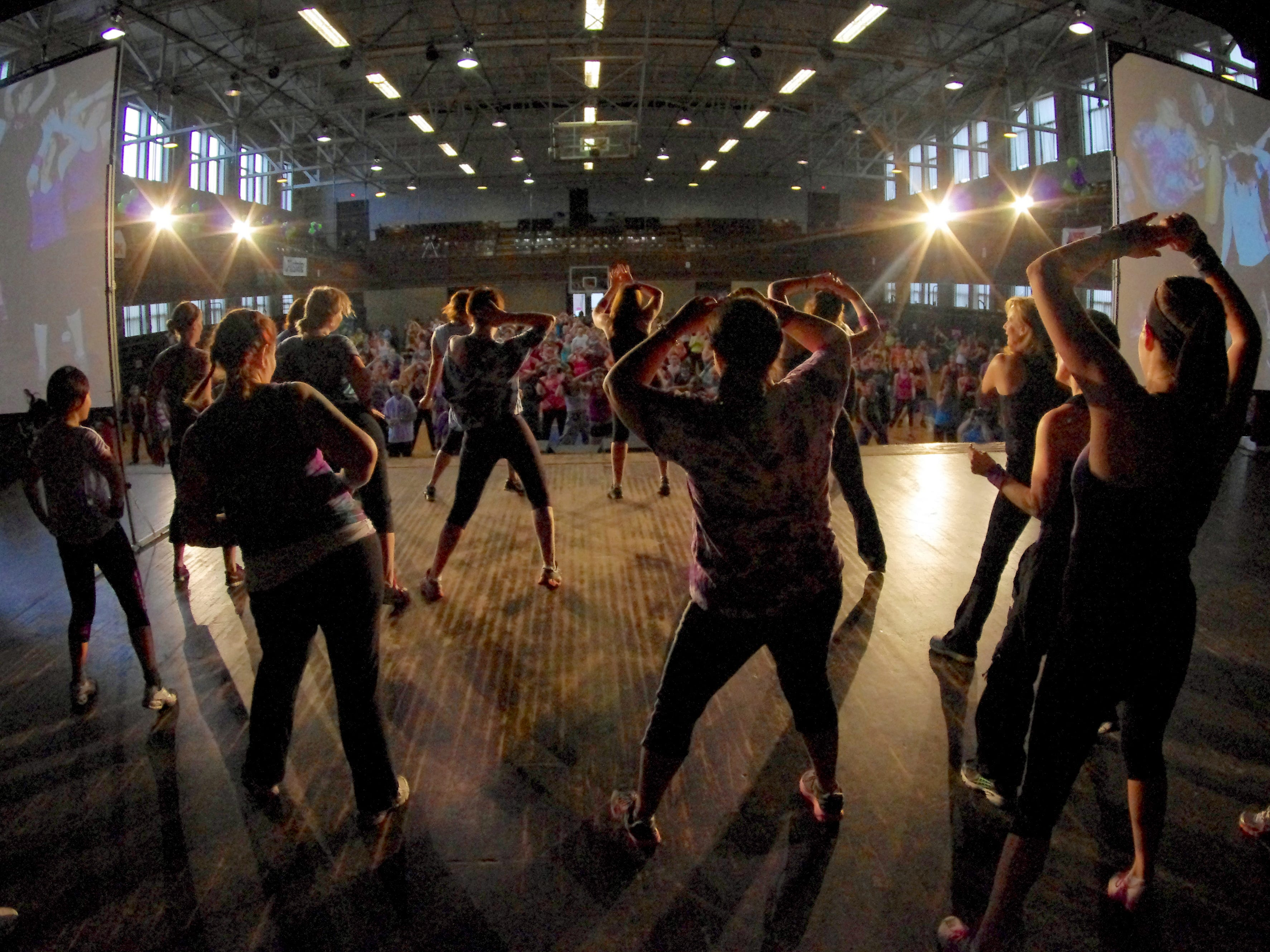 The 4th Annual WHBW Zumbathon kicks off at Memorial Auditorium in Burlington on Saturday, March 24, 2012. Photo by Steve Mease.