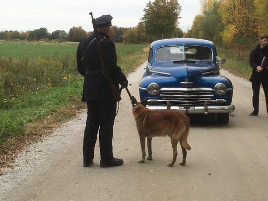 "Cpl. David Dewey, left, and K9 Tazor on set of the film, ""Rest,"" which was shot in Swanton earlier this month."