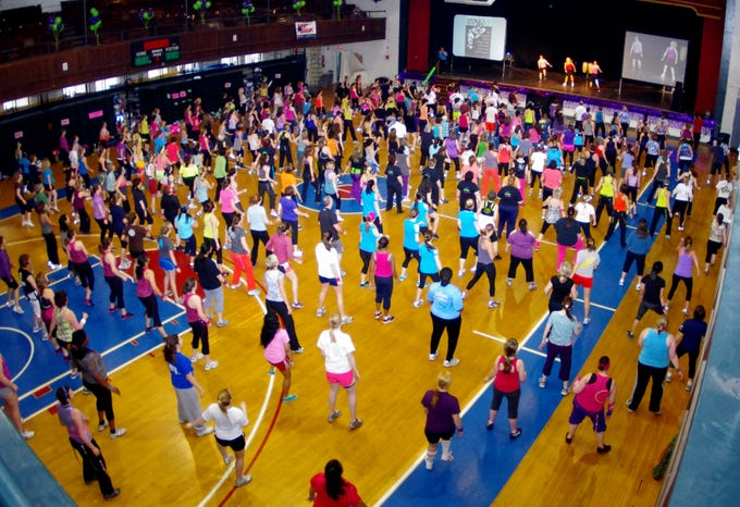 Participants in the 4th Annual WHBW Zumbathon ready themselves in Memorial Auditorium in Burlington on Saturday, March 24, 2012 in this photograph by Steve Mease.