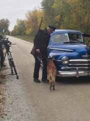 "Colchester police Cpl. David Dewey and K9 Tazor were characters in a short film called ""Rest,"" which was filmed earlier this month in Swanton. Dewey and Tazor played a guard and guard dog who were checking a car for a fugitive."