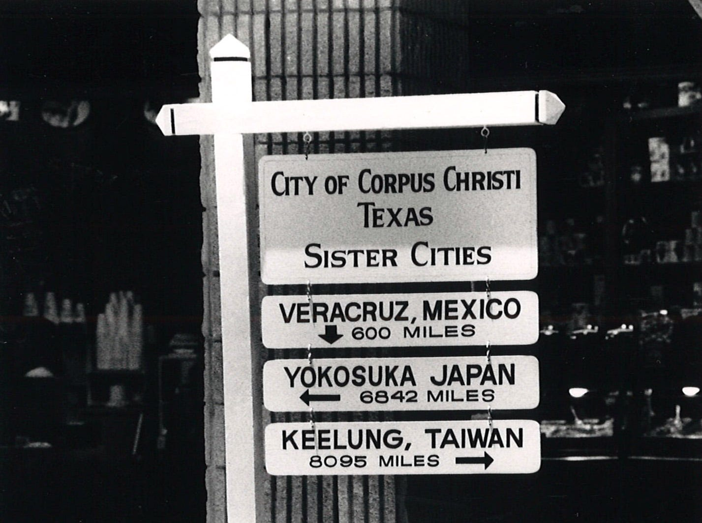 A sign post placed by Corpus Christi's Sister Cities program inside Sunrise Mall on July 25, 1989.