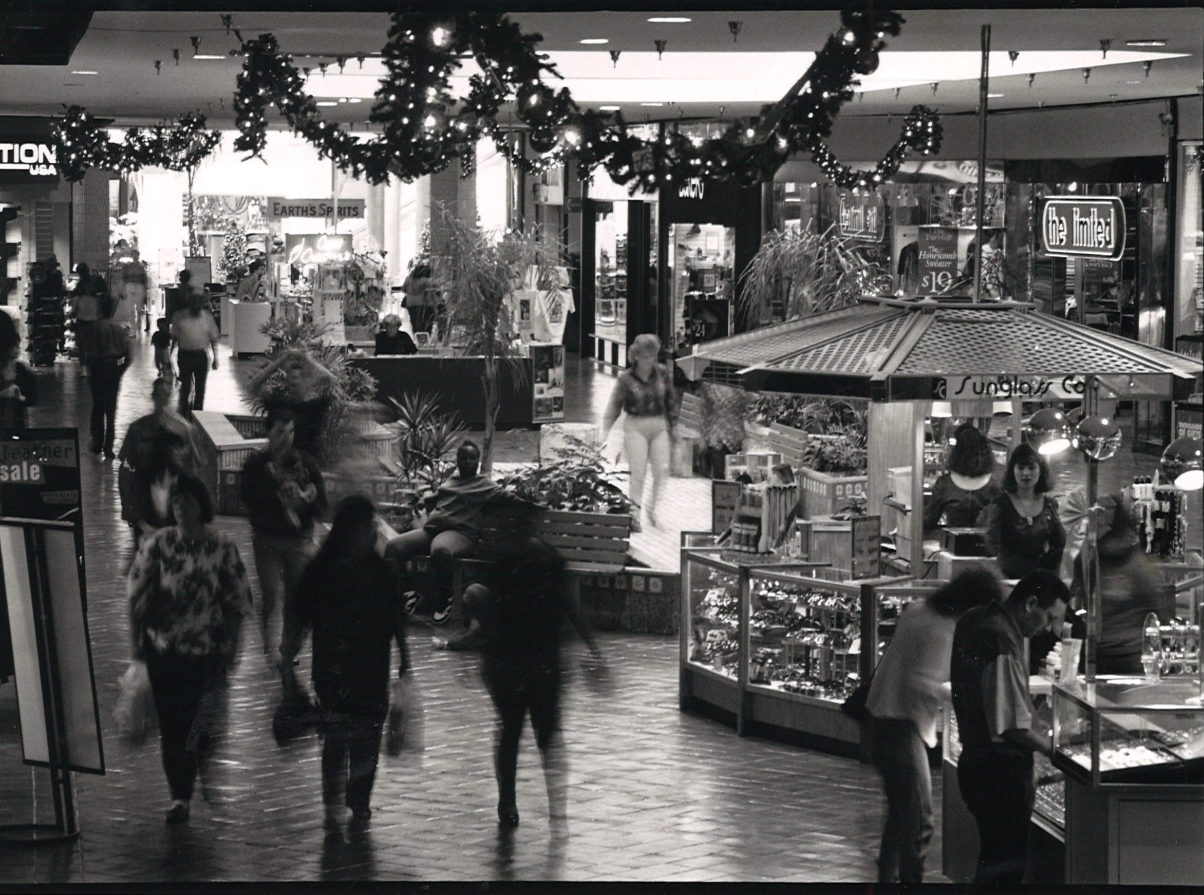 Christmas shoppers search for gifts at Sunrise Mall on Nov. 23, 1993.