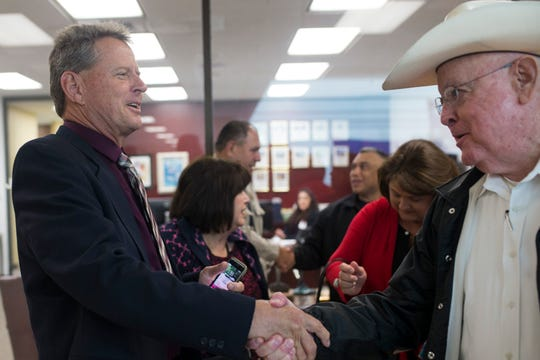 John Chris Hooper (left) shakes hands with Sheriff Jim Kaelin after being hired to replace him as Nueces County Sheriff on Wednesday, Oct. 7, 2018.