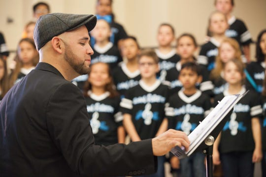 Matthew Trevino directs the Trailblazer Singers at Roan Forest Elementary in San Antonio.