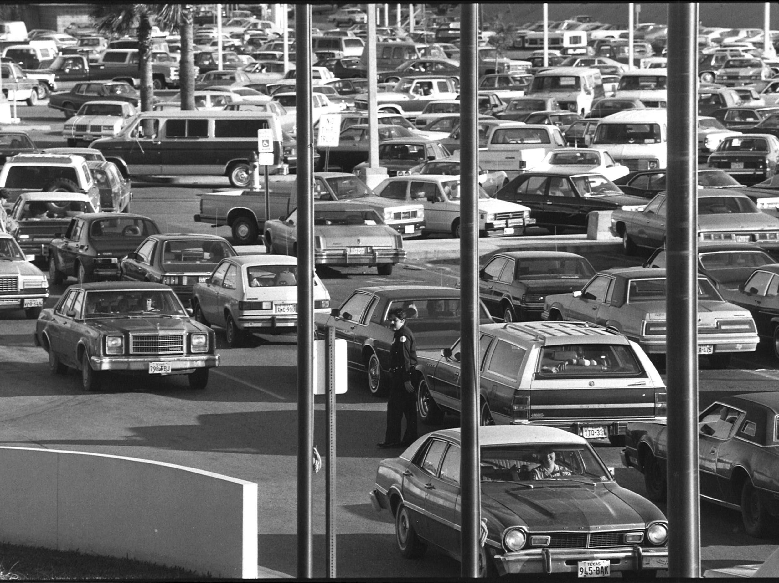 Special officer Martin Reyna Jr., with Sunrise Mall security monitors the parking lot and traffic in Nov. 25, 1983.