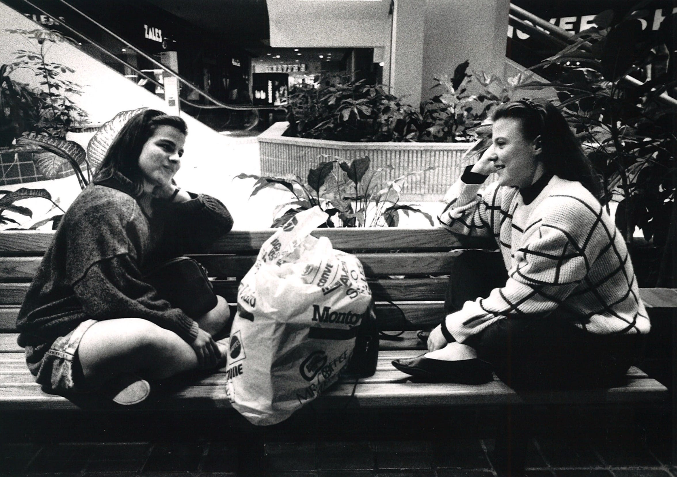Rosario Gonzalez Garcia (left) and Eugenia Gonzalez Garcia of Monterrey, take a break from some heavy shopping at Sunrise Mall on March 21, 1989. Many Mexican nationals were shopping at the mall before the Easter holidays.