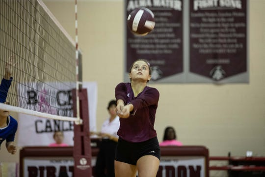 London's Emilie Cagle bumps the ball during their game against George West at London High School on Tuesday, Oct. 16, 2018.