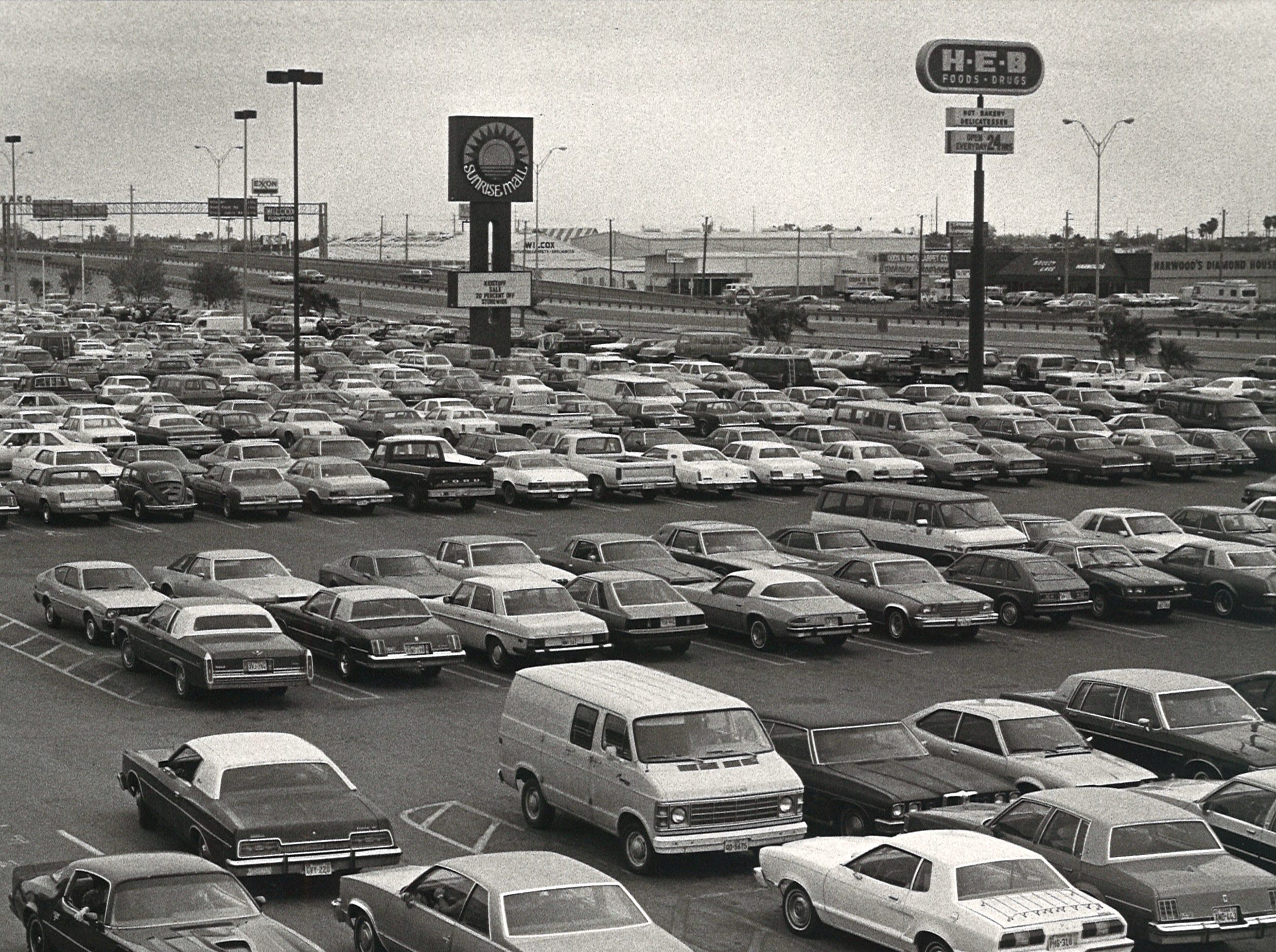 The parking lot of Sunrise Mall was jammed on Nov. 27, 1981 and cars parked illegally were being towed.