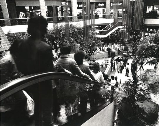 Crowds at Sunrise Mall stayed warm and took advantage of the after Christmas sales on Dec. 26, 1983.
