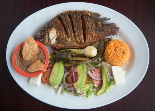 Mojarra frita at Parrilla La Nueva Fogata restaurant in Berlin.