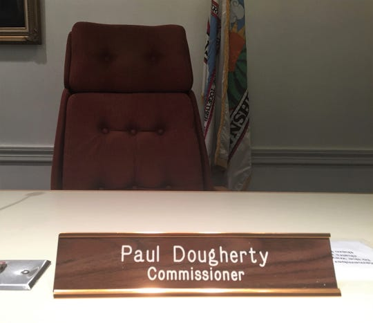 A nameplate marks Paul Dougherty's vacant seat before Tuesday night's meeting of Haddon Township commissioners.
