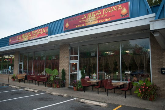 The colorful Parrilla La Nueva Fogata restaurant is located in a strip mall in Berlin.