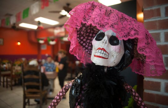 A Day of the Dead ornament decorates the interior of Parrilla La Nueva Fogata restaurant in Berlin.