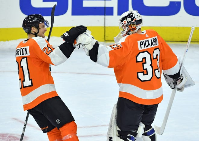 Oct 16, 2018; Philadelphia, PA, USA; Philadelphia Flyers center Scott Laughton (21) and goaltender Calvin Pickard (33) celebrate win during the shootout period against the Florida Panthers at Wells Fargo Center. Mandatory Credit: Eric Hartline-USA TODAY Sports