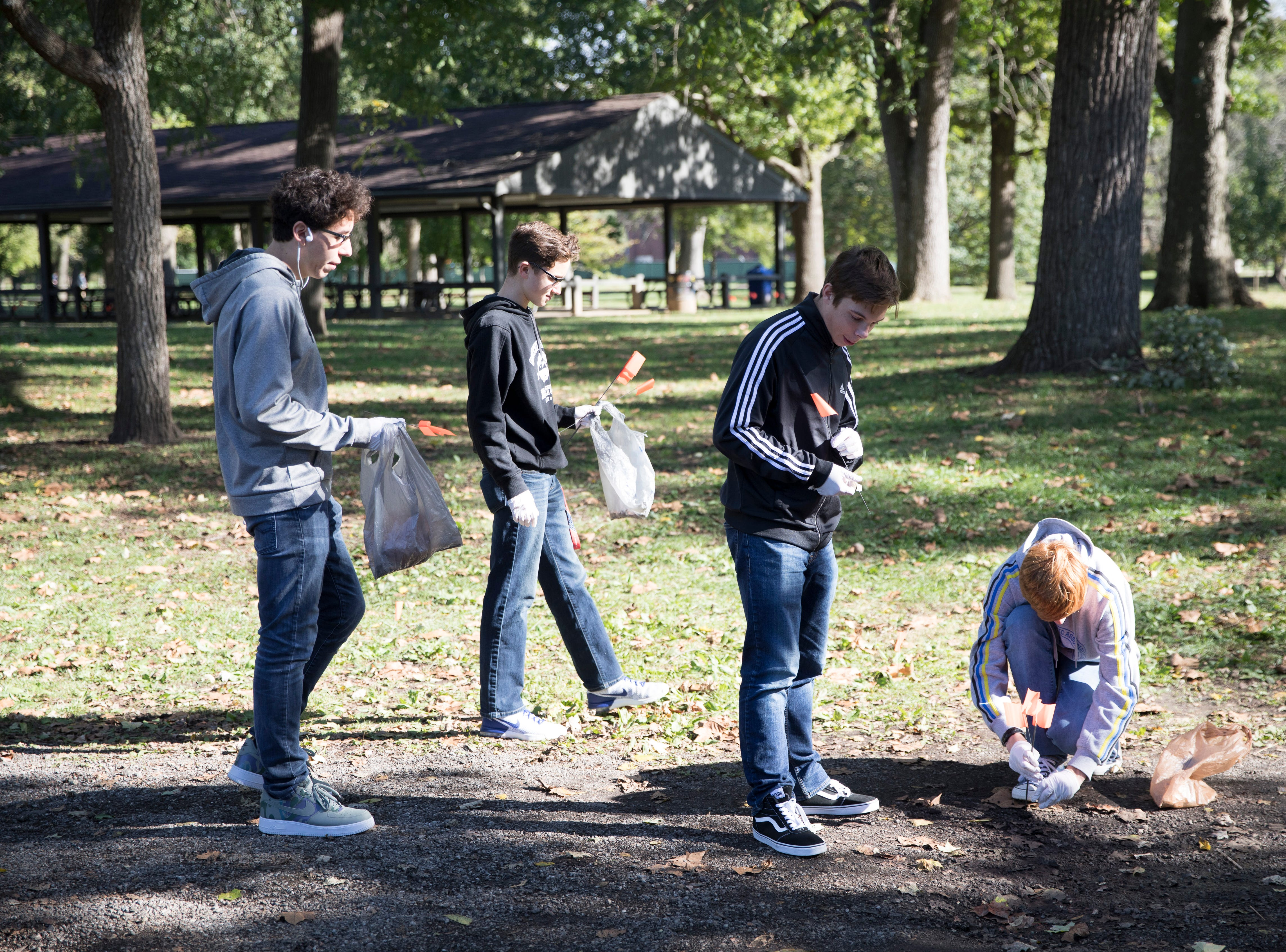 To illustrate how cigarette smoking is still an issue in today's society, about 160 students from Chillicothe High School's Keys to Success program spent an hour Wednesday morning at Yoctangee Park picking up cigarette butts and replacing them with orange flag markers to help build momentum for the Great American Smokeout in November, which is sponsored by the American Cancer Society.