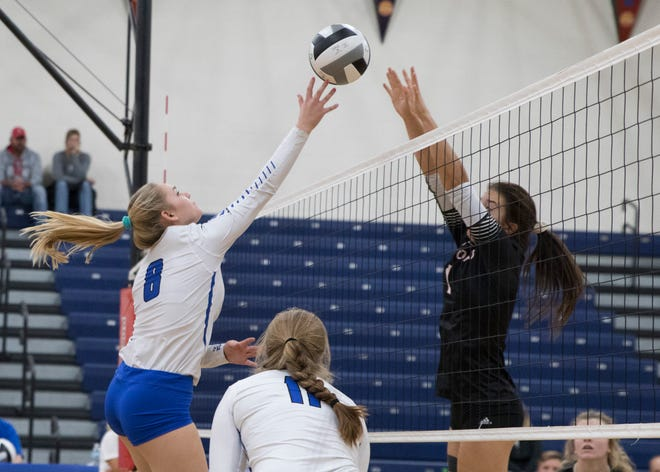 Oak Hill tries to block a ball returned by Southeastern' s Hannah Lougheed Tuesday night at Southeastern High School. Southeastern defeated Oak Hill 3-0 and advances to sectional finals.